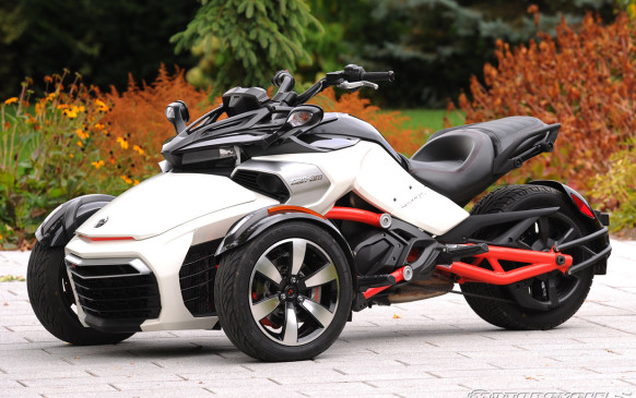 """<p>The Spyder uses a Rotax 1.0-litre V-2 gasoline engine, good for 106 horsepower and 77 lb-ft of torque, working through a five-speed manual or five-speed sequential semi-automatic transmission. Both offer a genuine reverse gear, since the Spyder tips the scales at a very substantial 317 kg. The Can-Am Spyder is quick, sprinting to 97 km/h in just 4.5 seconds. Fortunately, the machine provides traction and stability controls, power steering and even antilock brakes. There's decent luggage space under the front hood, something riders have taken to calling the """"frunk."""" Best of all, the Spyder is put together in Valcourt, Quebec.</p>"""