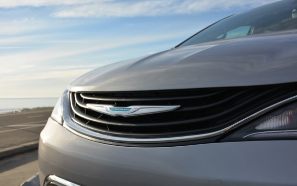 <p>The Pacifica Hybrid retains the basic style and size of its regular counterparts. Apart from the charge port identified by a lower case 'e' on a blue leaf, there are subtle changes that include a unique grille with a wave pattern rather than the typical mesh. It also sports a Chrysler logo in a teal blue colour in the middle of the grille.</p>