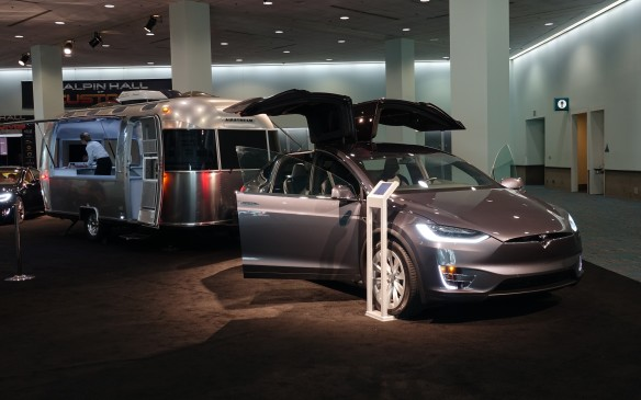 <p>Headlining Tesla Motors' discrete presence at the L.A. Auto Show was this all-electric Model X crossover with a classic, aluminium-body Airstream trailer hooked up to its rear hitch. This promises seriously stylish camping, indeed.</p>