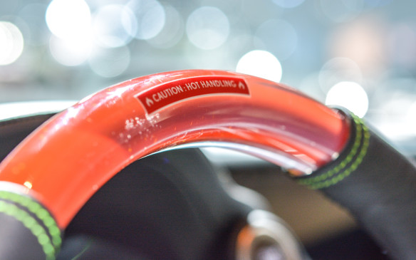 "<p>A Sriracha-like liquid was cast in resin, then formed into a Lexus steering wheel, complete with a warning for ""Hot Handling.""</p>"