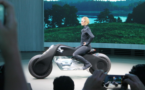 <p>The bike was driven onto the stage by a rider who did not have to put her feet down when she came to a stop – the motorcycle keeps itself upright with an internal gyroscope, like a Segway.</p>