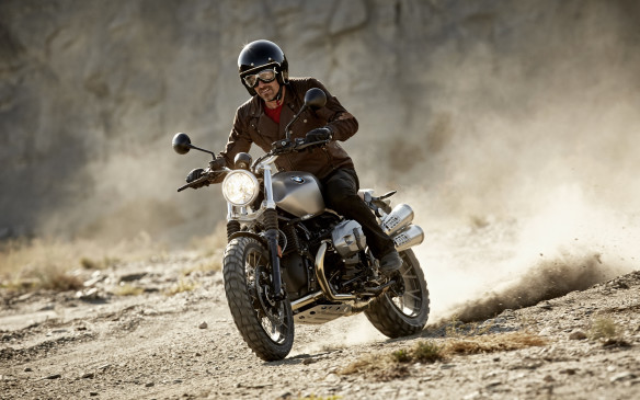 <p>The BMW Scrambler uses a 1,170-cc version of the classic boxer-twin engine, shared with several other designs of the base R Nine T bike (retro, racer, pure and Urban GS). Handlebars are high and wide and the suspension is a little longer, making this a popular choice for both dirt road and urban riders.</p>