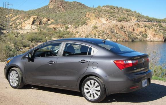 2012 Kia Rio sedan - rear quarter
