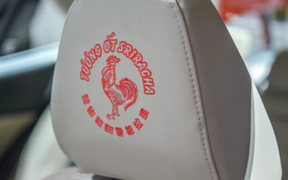 <p>We can't be sure, but we doubt that Huy Fong Foods founder, David Tran ever imagined his rooster logo would adorn the headrests of a Lexus in hand-embroided rich red stitching.</p>