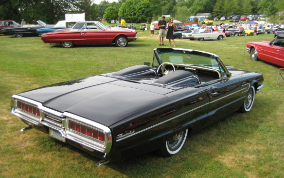 <p>A factory installed rear-seat tonneau makes this four-seat '65 Thunderbird Sports Roadster a two-eater like the original. And a beauty it is, surrounded by siblings.</p>