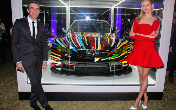 <p>Supermodel and actress Karolína Kurková joined artist Jeff Koons for the North American unveiling of his BMW M3 GT2 Art Car in the Miami Beach Botanical Gardens as part of Art Basel in December, 2013.</p>