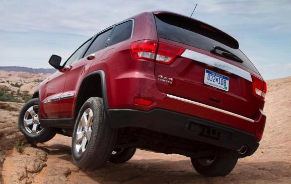 2011 Jeep Grand Cherokee - rear 3/4 view, rugged