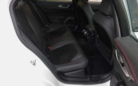 <p>The Giulia's rear seat provides acceptable comfort and room for the two passengers who will also enjoy the cool air from a pair of large air outlets on warm days. The middle spot is much less inviting, with the tall transmission tunnel and space-robbing aft section of the centre console.</p>