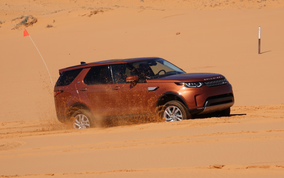 <p>Deep sand, heavy and moist under its sun-baked crust, was a good test for the Discovery's optional, dual-range, all-wheel drive system. With Terrain Response 2 in sand mode, it eventually climbed the tallest dunes, its diesel engine growling away in low range. The triangular orange flag atop a tall and thin white pole is a must while driving over huge, rolling sand dunes that can hide a Defender, if not a Hummer, in their creases.</p>