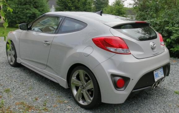2013 Hyundai Veloster Turbo - rear 3/4 view