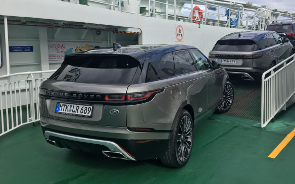 <p>With its 50,000 islands and 80,000km of jagged coastline, ferry rides are just about inevitable in Norway. The Velar took it all in stride, of course. One never ceases to be impressed by its slick and exquisitely tapered rear section. The LED taillights shine out of a narrow, black, horizontal trim bar. At the top of the rear window, at the top of a rear tailgate made of composite material, a full-width brake light remains hidden until it lights up. With its glossy black 'floating' roof, the new Velar remains true to Range Rover's modern styling code.</p>