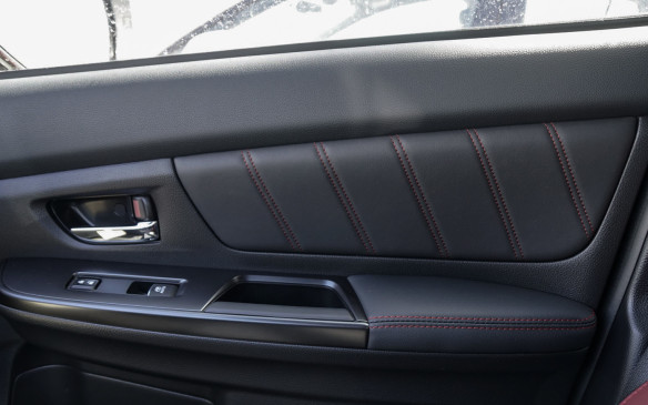 <p>Door panels have been revamped on both the WRX and WRX STI, the latter getting soft leather trim, with red stitching, also for its armrests. In all cases, a refreshing change from the forever stark interior ambiance of the Subaru performance stalwarts.</p>