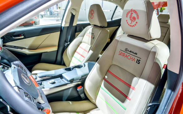 <p>In the case of the seats, you don't need to look that closely after all; the Sriracha love is rather apparent. It's all the conservative design Lexus is known for with a bold hit of Sriracha-style spice.</p>