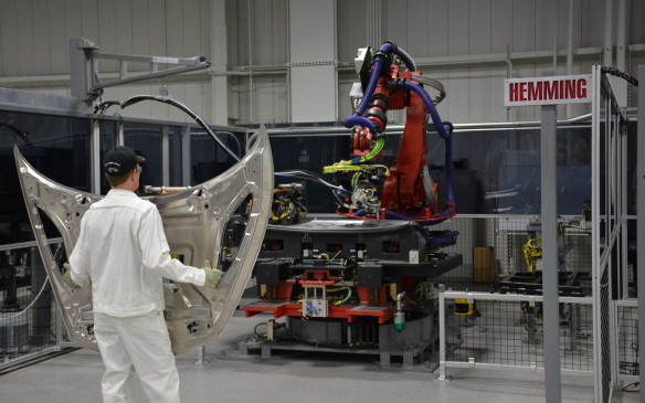 <p>Almost everything that is done at the PMC involves both man and machine. This is evident in most of the stations visited on this tour and includes the 360-degree rotisserie-style welding, hemming of lightweight metallic materials, the rotisserie sealer application, and the painting process, to name a few.</p>