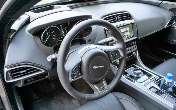 <p>The sedan's instrument panel continues a design theme first seen on the XJ, with a low-profile upper surface and a curved fillet that arcs around the base of the windshield and segues smoothly into the door panels. The structure ahead of the instrument binnacle indicates this XE has a head-up display. Despite a sportily low-slung driving position, forward visibility is fine but thickish A-pillars and a large door mirror can obscure visibility in the 10-11 o'clock direction. The outer fresh-air vents are positioned unusually low.</p>