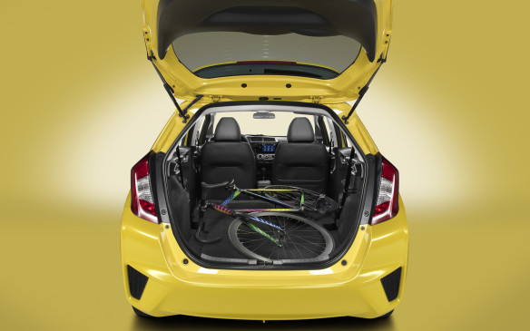 <p>Passenger space is comparable with some of the roomiest cars from the next size class up, ditto cargo space with the rear seats folded. And the Fit provides more ways of combining cargo and passengers than any rival. There are four grades of Fit, starting at $14,575. Figure on $18,675 with A/C and automatic. The range tops out at $22,675 for the EX-L Navi with navigation, leather, automatic climate control and push-button start.</p>