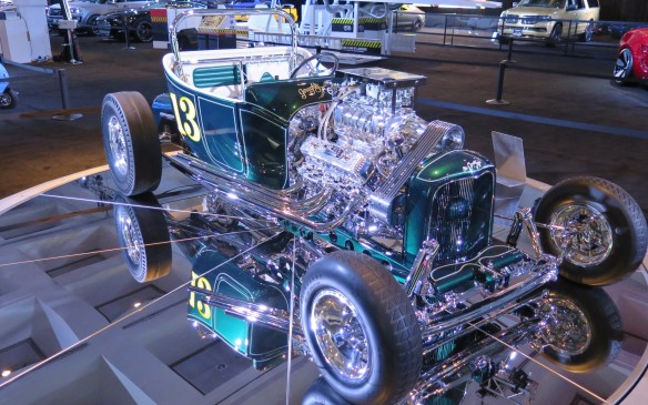 """<p>The Galpin folks have lovingly recreated the famous Grasshopper Roadster from the late '50s, a '23 T-Bucket body shell and hot rod chassis painted in """"Crème de Mint"""" with lots of chrome and a '57 Oldsmobile V-8 bored and stroked to 480 cubic inches. The big Enderle blower provides 18 pounds of boost. The frame, chrome bell housing and even the brake backing plates were drilled to reduce weight.</p>"""