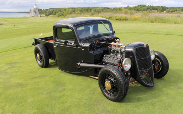 <p>Another pickup, which started life as a 1936 Ford, took top honours in the Traditional Hot Rod class. Nothing makes it more traditional than its flathead V-8 with three carburetors.</p>