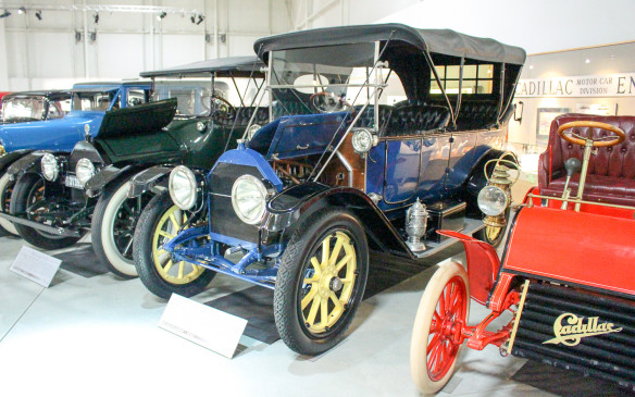 <p>Several other historically significant Cadillacs were part of the display, including the red 1903 Model A runabout in the foreground – the first series produced by Cadillac after it was formed from the residue of Henry Ford's second attempted company. The blue 1912 Touring model, center, included a feature that changed the course of the auto industry.</p>