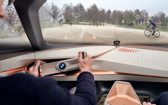 <p>If the journey promises to be more enjoyable, however, you can drive the car yourself. The steering wheel – actually, a bar with handles, like on a fighter jet – will extend from the dash and let you make all the decisions. BMW calls this Boost mode.</p>