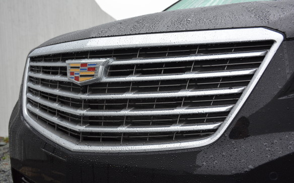 <p>The XT5 has adopted Cadillac's sophisticated new signature chrome grille as seen on the CT6. The chrome from the grille shines and works well with its thin and sleek tomahawk-shaped LED headlights. The top Platinum trim has a different front fascia with thinner horizontal lines coming across its grille.</p>
