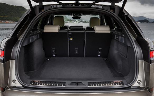 <p>Swing a foot under the rear bumper and the composite tailgate opens like magic on 673 litres of practical cargo volume, with aluminum scuff plates on a pleasantly low sill. Loading volume goes up to 1,731 litres if you fold all three sections of the rear seatback (in 40/20/40 proportions) flat, which is easily done from the rear, with release levers. The centre portion of the seatback doubles as a hatch for skis or snowboards. A full-size temporary spare is nestled under the load floor.</p>