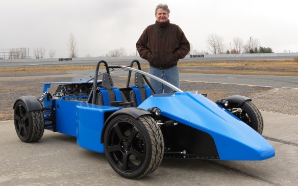 <p>Self-taught designer and builder Daniel Campagna stands next to the first prototype of the Talisman, the lightweight, four-wheel performance machine he chose to concentrate on and bring to production, after toying with several concepts for years. On this day, in late November of 2014, I was the first outsider to drive the Talisman on the road course inside the Sanair tri-oval in Québec. On pavement close to the freezing point, it showed great balance and the promise of sharp handling, in spite of slow-reacting steering and a stuttering engine. Campagna took notes and brought it back to the shop.</p>
