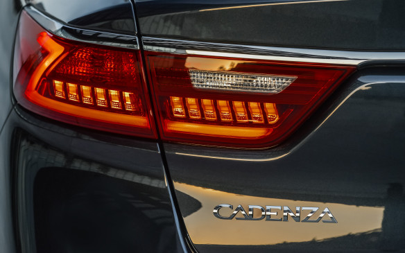 <p>There are Z-shaped light bars beside the tail lights, too. It's the car's signature. And it's an attractive piece, as most Kias have been since former Audi designer Peter Schreyer took over their design responsibility a decade ago.</p>