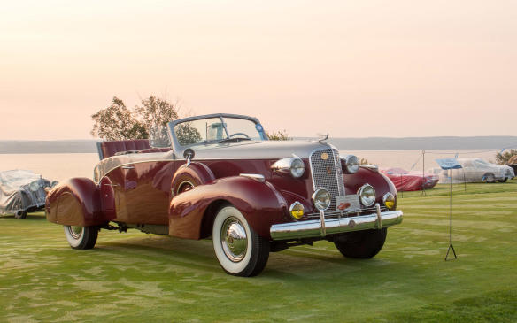 "<p>As dawn broke, many cars were already in place on the show field, including this ""one-off,"" Fleetwood-bodied, 1937 Cadillac V-12 Boat-tail Roadster.</p>"