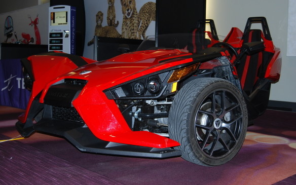 <p>Polaris Slingshot, a 3-wheel motorcycle, on a reverse trike frame combines motorcycle with car.  Low to the ground, the open-air concept allows you to feel the wind in your hair and potentially get bugs in your teeth too.  Make sure you find all 3 (two red and one white) to see just how cool these machines are, in person.</p>