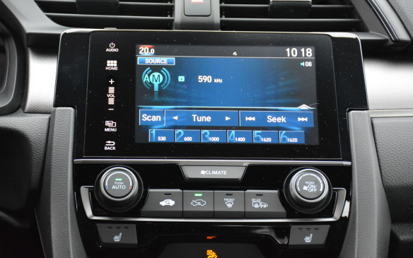 <p>If there's anything to get picky about it's the Civic's volume control and fonts. Honda will soon offer a physical volume knob in the new CR-V, but for now the Civic is sticking with a touch slider that effectively forces one to use the volume controls on the steering wheel.</p> <p>The seven-inch touchscreen fonts come in Honda's traditional block forms. They're large and unexciting, but at least they're easy to read.</p>