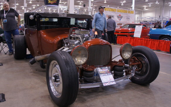 <p>This gorgeous hot rod was hand-built by owner Bill Denny. Aside from its spotless copper and black paint, it has some interesting features, including air suspension and unique door handles created from wrenches.</p>