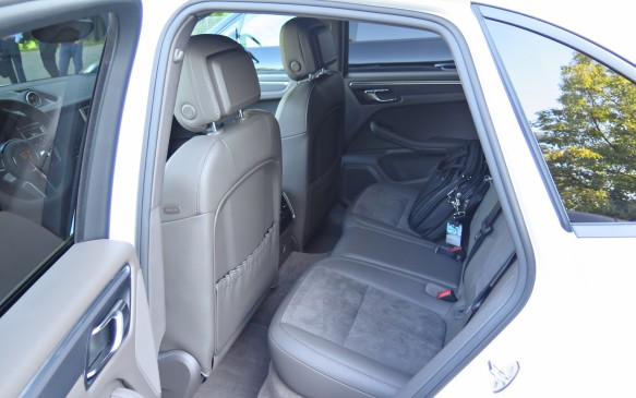 <p>The rear seat accommodations are tight in terms of head and legroom, however. The bench is split 40/20/40 with the middle able to serve as an armrest with the back folded down – a good idea since there is little space for a middle occupant back there. The cargo area behind the second row is more coupe-like in size than CUV. There is storage below the floor and the liftgate is powered.</p>