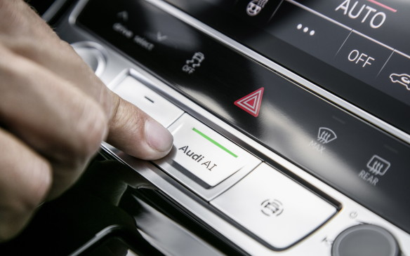 <p>If your drive meets all those conditions of typical freeway congestion, as ours did, then it's time to press the AI button (for Audi Intelligence) to activate the Traffic Jam Pilot feature.</p>