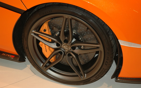 <p>Pirelli is the tire supplier for McLaren's Formula One team, so of course it also supplies rubber for the road cars. Carbon-ceramic brakes are standard. A key difference from other McLarens is a simpler and more affordable passive suspension system, i.e. without the active hydraulic body-motion controls of the higher-end cars.</p>