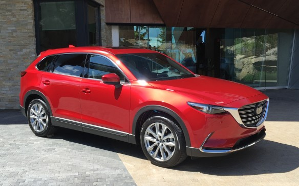 <p>Pricing for the 2016 Mazda CX-9, which ranges from around $35,000 to 50,000, slots neatly into the intermediate SUV/CUV segment, which has an average price of $41,000. In fact, it mirrors the price range for the Honda Pilot. The base CX-9 GS with front-wheel drive is $35,300 and its list of standard features includes a high-grade cloth interior, three-zone automatic climate control with rear control and display panel, pushbutton start, electronic parking brake and a seven-inch touchscreen with Mazda Connect. If you prefer all-wheel drive, it's an additional $2,500.  </p> <p>The GS-L, which is expected to be the volume leader, lists at $41,500, including AWD, and adds such features as leather upholstery, power moonroof, keyless entry, rain-sensing wipers, four-way power-adjustable passenger's seat, a larger (eight-inch) touchscreen, LED fog lights, blind spot monitoring, rear cross-traffic alert and Smart City Brake support and a height-adjustable power liftgate.  </p> <p>The GT trim (with AWD standard), previously the top of the lineup, is $45,500. Its list of additional features includes the Bose audio system, navigation, driver's seat memory, retractable rear sunshades, a black headliner and 4.6-inch multifunction information display. An upgrade with the Technical Package is offered at $1,600 and includes adaptive cruise control, forward obstruction warning, lane departure and lane-keep assist systems plus automatic high-beam headlight control.   </p> <p>The new premium Signature model is $50,100. It adds the plush Chroma Brown Nappa leather interior, detailed stitching on the seats and steering wheel, the authentic rosewood inserts and ambient LED interior lighting. The only other added-cost items offered involve paint finishes – white pearl adds $200; Soul Red metallic is $300 (GS-L and GT) and the new Machine Grey metallic (GS-L, GT, Signature) is $300. Shipping and dealer prepping is $1,895 across the board. The $100 air-conditioning surcharge is also additional.</p>