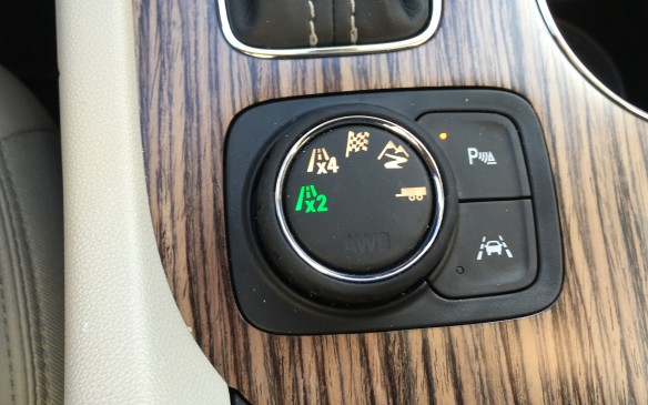 <p>All-wheel drive models feature a traction control selector mounted on the console that enables the driver to adjust the vehicle's performance for various road conditions. Two all-wheel drive systems are offered, with both having an AWD disconnect at the front PTO. The standard AWD system is a single-clutch system with an open differential, while All Terrain models use an advanced AWD system with active KNG twin clutches. Settings on the console selector on All Terrain models replace the off-road mode with a specific mode for enhanced hill-climbing capabilities.</p>