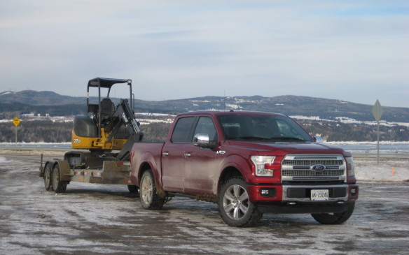 "<p>The new F-150's power-to-weight ratio has improved from five to 16%, also depending on the powertrain. For this testing session, a payload consisting of a tow-motor that weighed approximately 385 kg (850 lb) was strapped into the aluminum pickup box, while the trailer-towing trial involved an excavator loaded on a dual-axle construction flatbed with a total weight of about 8,500 lbs (3,855 kg). Driven over a combination of flat, urban terrain and hilly country roads, the trucks handled both loads without an issue.</p> <p>For a video take on this adventure from our friends at Wheels on Edge, <a href=""http://www.wheelsonedge.com/Article/148/The-2015-Ford-F-150-Takes-On-Old-Man-Winter"">click here</a>.</p>"