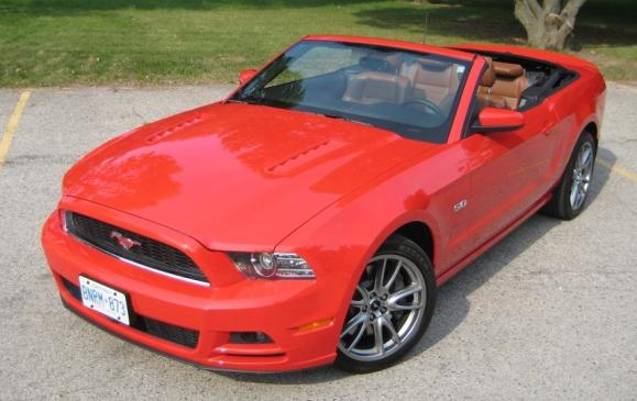 2013 Ford Mustang GT convertible - front 3/4 view high