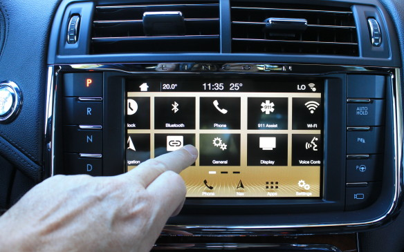<p>The central display is a full touch screen. It accommodates pinches to zoom the map, and swipes between apps.</p>