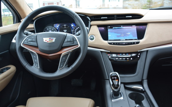 <p>The XT5's exterior suggests a more mature SRX while the interior makes one easily forget about that outgoing model. Inside, there's a horizontal motif that creates a wider appearance while the instrument panel is clean, smooth and simplified. Moving up to the Platinum trim level adds a suede material to the soft leather IP.</p>