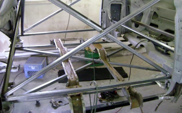 <p>The floor was eaten away by rust so the process begins of constructing a new one. Which involves bracing and properly locating the front and rear portions of the car.</p>