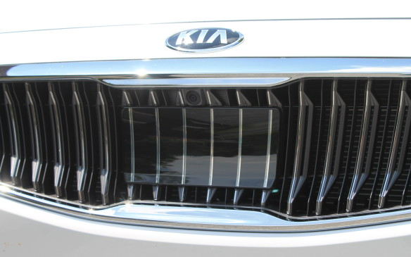 <p>That clear plastic panel in the front grille is for the radar to bounce back off, to more accurately determine the distance between the Cadenza and objects in front of it.</p>