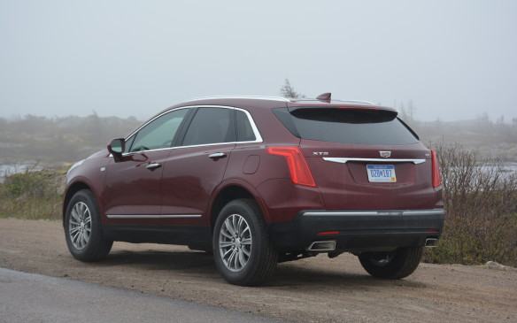 <p>The front view of the XT5 commands attention, but isn't highly aggressive when compared to its competition. The XT5 takes on a softer look that is more refined with a swept-back design that's rounded out by a unique exhaust in Platinum trim.</p>