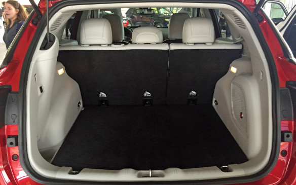 <p>The cargo area has been designed for minimal intrusion and easy access through a wide opening, and it boasts a multi-level cargo floor with a reversible mat. The front passenger seat folds flat, allowing long items to be accommodated. A hands-free opening system is also available.</p>