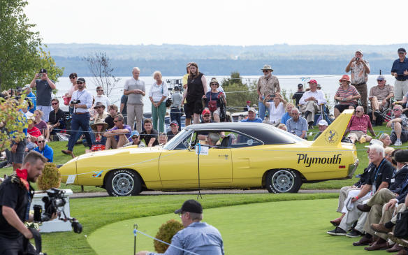 <p>There had to be Muscle Cars, among them this long-nosed, high-winged1970 Plymouth Superbird.</p>