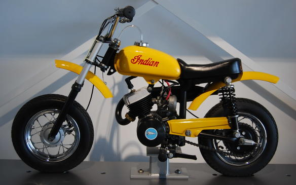 """<p>In an effort to keep pace with the changing market, both Indian and Harley-Davidson introduced minibikes to their lineups of full-size machines. Importer Floyd Clymer, added Italjet's Mini Mini Bambino """"minicycles"""" to the Indian name, but after his death in 1970, the Indian trademark passed to an attorney in Los Angeles who continued importing the MM5A.</p> <p>With three colours to choose from, the """"miniaturized motorcycle"""", designed to familiarize children with the Indian brand, featured a 50cc engine with a centrifugal clutch.</p>"""