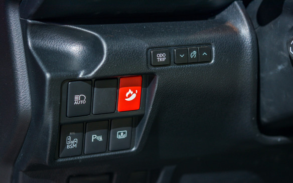 <p>We're not sure what this button activates, but it looks like hitting will make things extra spicy in the car.</p>