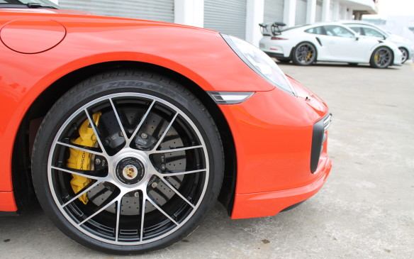 <p>The large wheels hold large brakes. Both Turbos have ceramic brakes as standard, with six-piston, 380-mm discs at the rear.</p>