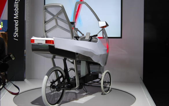 <p>In the Denso booth, you will find some sort of weird electric bicycle on display. The video shows an animation of a person putting coffees in the back seat of this bicycle and then it drives/rides away. All by itself. It showcases wireless charging, indicator lights but no seat. Weird!</p>